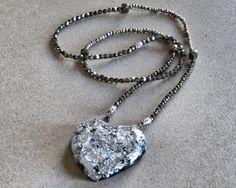 Heart of ice   hndmade necklace in pyrite and crystals, pendant with resin and silver leaf  http://www.mimietoile.it/en/shop/heart-of-ice/