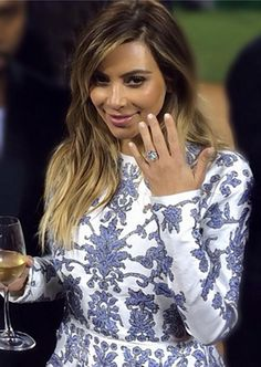 Kim Kardashian flashed her 15-carat engagement ring in front of friends and family Monday night. #Kimye
