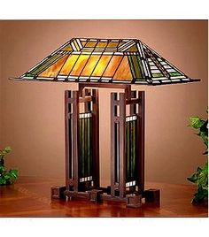 Frank Lloyd Wright Mission Style Table Lamp Tiffany style mission lampTiffany lamp in mission style - htdeco. Big collection of Tiffany lamps Dragonfly, butterflies and table lamps. Swing Arm Wall Lamps, Arc Floor Lamps, Tiffany Stained Glass, Stained Glass Lamps, L'art Du Vitrail, Craftsman Lighting, Lampe Art Deco, Mission Style Furniture, Craftsman Furniture
