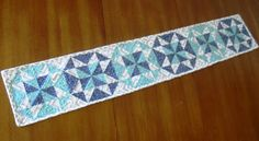 @Melissa Corry  (Happy Quilting) has turned star quilt block patterns into a gorgeous table runner, and you can too!