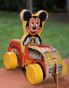*PUDDLE JUMPER ~ this is a very aged and well played with Fisher Price mickey Mouse Puddle jumper pull toy, c. 1954.