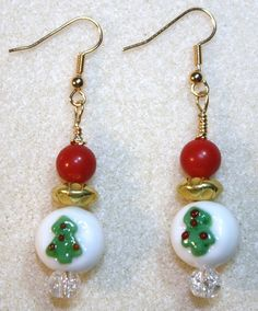 Handcrafted by Teal Palmetto, LLC. Lots of bling in these Christmas tree earrings!  Sparkly, clear crystal beads are topped by the glass Christmas tree focal beads.  Those are topped with shiny gold metal and red glass beads.  This pair has gold fish hook ear wires.  Price: $14.