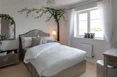 Like the tree on the wall and the garden themes mirror  New homes for sale in Slough, Berkshire from Bellway Homes