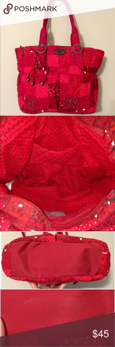 Incredible Red Quilted Donna Sharp Bag Amazing quilted Donna Sharp bag in rich shades of red.  EUC.  Double strap. Zippered closure.   2 front pockets.  Side pockets.  Large rear zippered pocket.  Removable tassels.  Very faint smudge on bottom of bag.  Strap has small mark and a little dingy on underside-not very noticeable.  This is a great bag!  Dimensions posted shortly. Donna Sharp Bags Totes