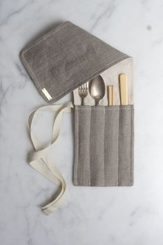 Honestly, I should be able to make something like this portable utensil wrap myself, but with a fabric pattern more fitting my aesthetic. Note that I have a robot-exterior, floral-interior (in bright apple green, teal, and sky blue) wristlet as a portable cord stash.