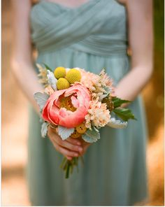 Teal bridesmaid dress and bouquet.