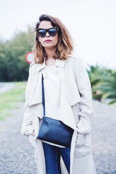 Trench.  Jeans.  Bag.  Shades