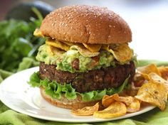 These spicy and smoky black bean burggers are topped with creamy guacamole and crispy plantain chips for an explosion of burger flavors and deliciousness.