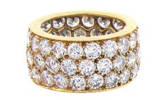 18K karat yellow gold diamond eternity ring, with 58 round brilliant cut diamonds weighing 8.65 carats.