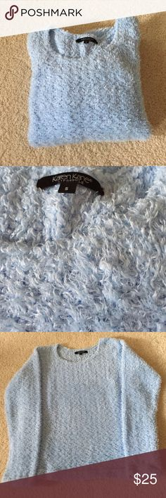 """Karen Kane Light Blue Fuzzy Sweater Excellent condition except for one spot in front that I'm not sure if it's just the material or if it's a slight flaw. See picture 2. Also, the color is more powder blue than the pictures show. Very soft with fuzzy texture. Crew neck. Has side slits at bottom. 18"""" from armpit to armpit. 21"""" long. Sleeves 23"""". 100% polyester. Hand wash cold. Lay flat to dry. Not from a smoke free house. Karen Kane Sweaters Crew & Scoop Necks"""