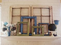 Old picture frames on a mantle - LOVE!