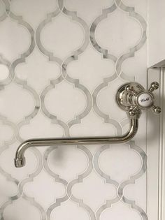 a vintage spigot swingarm pot filler lines a white and silver arabesque tile cooktop - Arabesque Tile Backsplash