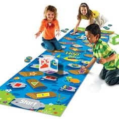 Crocodile Hop [EQ4026] - Turn them into happy hoppers: Crocodile Hop will have them giggling as they cross the river, navigating from number to color to shape! Super-sized vinyl floor mat gives them lots of space to play on their own, or in a group.