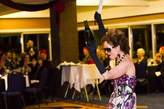 Alain Pinel Top Producing Realtors get a Great Show as Master Sommelier Catherine Fallis performs the art of Sabrage with the 2001 Spacy Odyssey theme song blasting Theme Song, Champagne, Songs, Concert, Top, Women, Concerts, Song Books, Crop Shirt