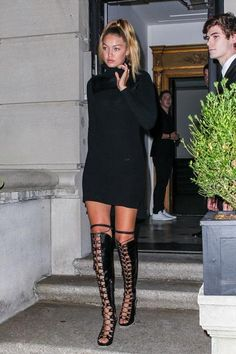 Gigi Hadid wearing Rodarte Black Embossed Over the Knee Lace Up Boots