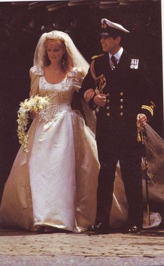 Sarah Ferguson - The Duchess of York - 1986. Really the best of the Royal wedding dresses. So flattering and very individual with the bridal couple's initials embroidered on the dress. The skirt, flaring from the fullest point of the hips, created a very flattering line and the slightly poufed sleeves showed uncommon restraint for the times.