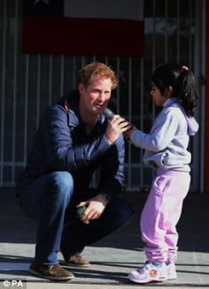 Pascal Vasquez, 7, steals the microphone from Prince Harry as he meets children with mental and physical disabilities