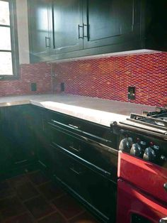 Beautiful #red tiled #kitchen backsplash