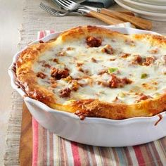 Family Pizza Pie « This recipe is quick and easy - it uses refrigerated buttermilk biscuit dough for the crust!