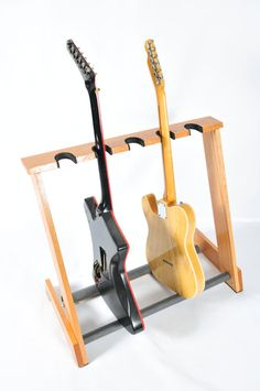 Multi spaced Red Oak guitar rack from allwood by AllwoodStands Cigar Box Guitar, Music Guitar, Ukulele, Guitar Hanger, Guitar Hooks, Guitar Wall, Diy Guitar Stand, Guitar Storage, Diy Rack