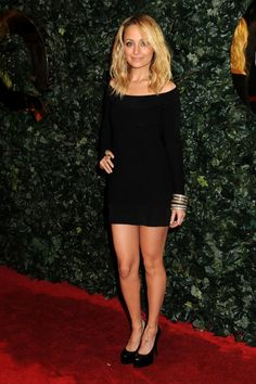 Nicole Richie my celebrity twin. Short black dress with long sleeves= sexy classy.
