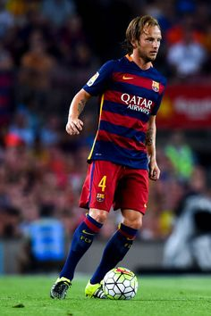 Ivan Rakitic of FC Barcelona runs with the ball during the Joan Gamper trophy match at Camp Nou on August 5, 2015 in Barcelona, Catalonia.