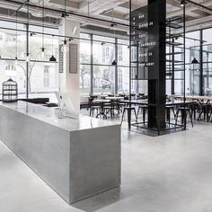 Usine Restaurant by Richard Lindvall @richardlindvall  A 2000 square meter former sausage #factory in #Stockholm has undergone an extensive #renovation to give place to the new Usine concept. The interior is inspired by #Scandinavian minimalism with an #industrial twist.  See more: http://on.fb.me/1JbndC0  #architecture #interiors #concrete #blacklaquer #steelframe #blackiron #restaurant #gallery