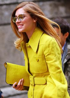like the hair, glasses, clutch, and style of coat, but not a fan of yellow