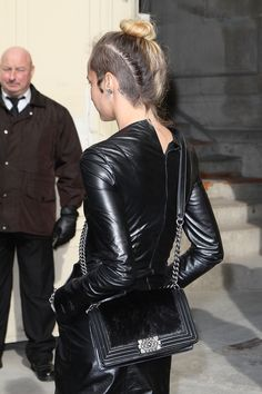 Alice Dellal: A back view of Alice's undercut and bun.