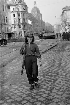 Erich Lessing  HUNGARY. Budapest. A member of the insurrection in front of the Maria Theresa barracks where most of the streetfighting against the Soviet troops took place. 1956