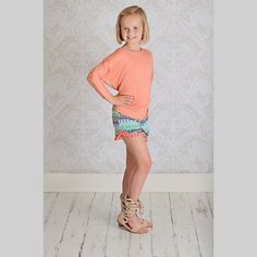Shop Betwixt - A Tween Boutique in the US; PomPom Shorts in orange. A Betwixt favorite.
