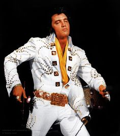 "THE GOD OF BEAUTY! ELVIS wearing the ADONIS( aka the COMET ) Jumpsuit. The suit had a matching gold lined cape and THE KING wore it with The Gold Attendace Belt. This suit made its debut on June 9 1972 at the first MSG concert. Kurt Russell wore this suit in the 1979 movie ""ELVIS"". He visited Graceland while preparing for the movie and Vernon suggested Kurt would try on one of ELVIS jumpsuits. They decided to use the suit in the movie. Vernon died in 1979 year and the suit was never…"