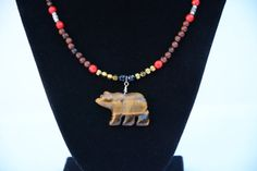 ★ Delicious Brown ★ Check out this Beautiful, Spirit bear necklace!! Bear is carved from natural yellow tiger's eye, necklace is adorned with semi-precious gem stones including gold stone, red coral and gold hematite. Stop by Flashin Fashin Jewelry to see more of our beautiful selection of necklaces, bracelets, earrings and more.... https://www.facebook.com/permalink.php?story_fbid=386700111509179&id=100005075808501&substory_index=1