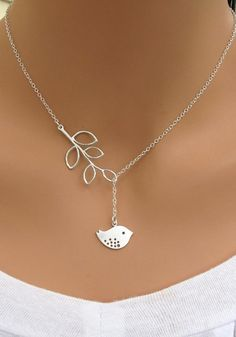 Brighten an overall classic look with this delicate silver necklace. It features a birdie and leaf pendants with clasp closure. It's the per...