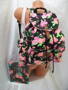 VS PINK Floral Backpack and planner.(i find it vey odd that the maniquine is half naked