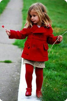 Red tights remind me of 1970-80s wear for toddlers (I had a outfit very similar to this). Very retro-vintage. Love the coat. G;)