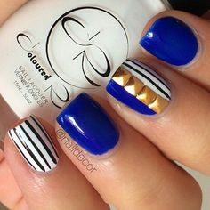 Blue studded black and white stripe nailart #nailart #summer #nails #black #white #stripe #studded #blue