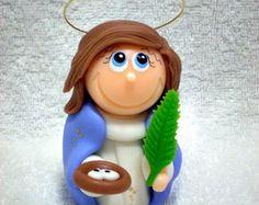 Santa Luzia - 8 cm de altura  http://www.elo7.com.br/atelierclaudiaaparecida