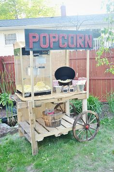 DIY popcorn stand made out of two pallets! Super easy to make & is great for weddings, graduation parties, birthdays, & more!