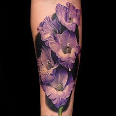 Flower Tattoos like sunflower tattoos and lotus flower tattoos are popular but there is more! Discover beautiful variations of floral tattoos now! 3d Flower Tattoos, Gladiolus Flower Tattoos, Realistic Flower Tattoo, Beautiful Flower Tattoos, Flower Tattoo Back, Flower Tattoo Designs, Rose Tattoos, Tatoos, Color Tattoos