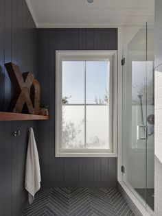 Grey bathroom, wainscoting on walls, dark grey floor with white grout herringbone pattern, rusty xo letters, white trim..no link