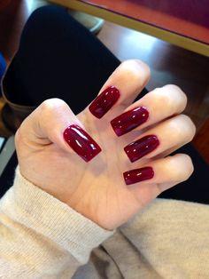 Long burgundy acrylic square nails.