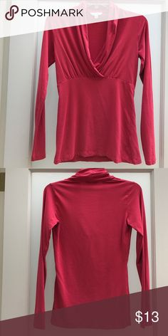 Flattering red CAbi v-neck long sleeve blouse Red CAbi v-neck top, very flattering with dress pants and a cami underneath. Beautiful red color... not super bright...more like a brick red, perfect for fall. CAbi Tops Blouses