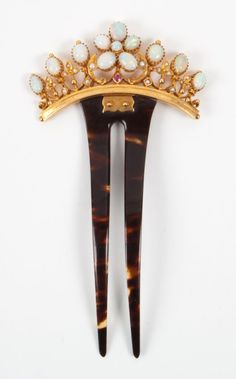 """Edwardian gold and opal hair ornament - circa 1900: gold crown set with opal cabochons, seed pearls and a single ruby, hinge-mounted to two-prong comb; 2 in. W., 4 1/2 in. L.; marked 15K and """"625"""", 13 grams t.w."""