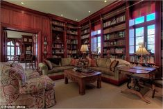 Joe Cocker's Colorado home is being sold.  The formal wood-paneled library has a traditional rolling library ladder and is perfect for curling up with a book