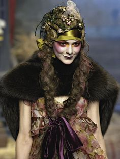 Sprite face on the runway. Cool hair and headdress.