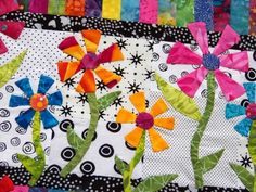 Floral applique with single fold bias stems. Very artful to extend the flowers past a defined border.  Attic Window Quilt Shop