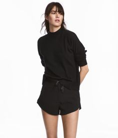 Black. Short shorts in woven, crêped fabric with a relaxed fit. Regular waist, elasticized drawstring waistband, and zip fly with concealed hook-and-eye