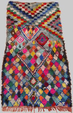 vintage Moroccan rug woven by hand from scraps of fabric / boucherouite / boucherouette. $150.00, via Etsy.