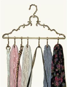 I have a TON of scarves so organizing the is always a hard task, this would make everything so much easier PARISIAN HANGER VALET